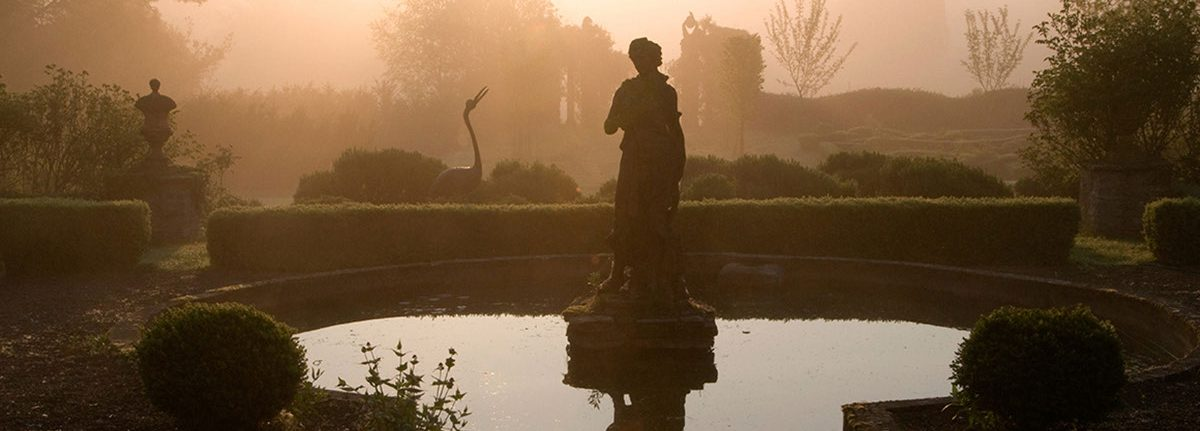 The Diana statue at dawn at Hellens Manor, Much Marcle, Herefordshire